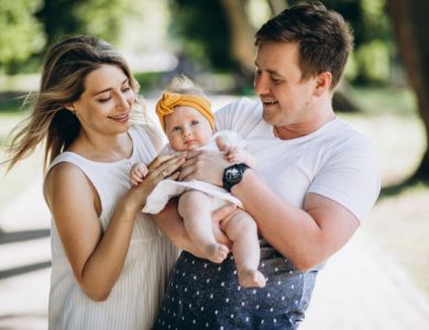 young-couple-with-their-baby-daughter-park_1303-16057